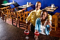 Young African couple having drinks in a restaurant