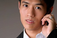 Business man with phone, closeup portrait with face.