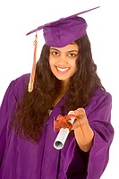 Young female in graduation gown holding her diploma