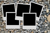 Pile of empty photo frames on stones background