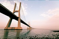 North towers of Vasco da Gama bridge on low tide