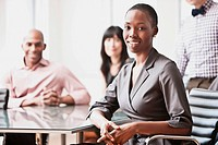 Portrait of businesswoman with colleagues in background