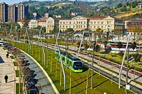 Abandoibarra avenue and tram. In the background Padre Arrupe footbridge and University of Deusto. Bilbao. Bizkaia. Vizcaya. Pais Vasco. Euskadi. Basqu...