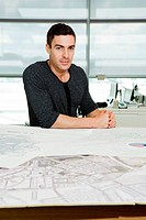 Portrait of an architect working on blueprints in office
