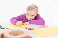 Girl making greeting card, portrait
