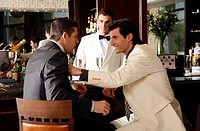 Two men in agreement at a bar (thumbnail)