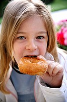 Young girl eating a doughnut