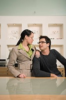 Couple posing with eyeglasses in store