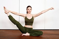 Young woman performing a pilates stretch (thumbnail)