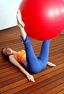 Young woman performing a pilates exercise