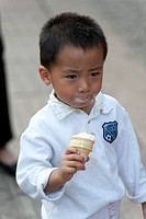 Boy licking an ice cream, Binhai, Tianjin, China