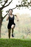 Picture of a woman running through the park.