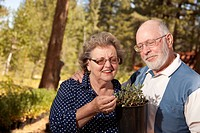 Attractive Senior Couple Overlooking Potted Plants at the Nursery.