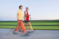 Senior citizens, man and woman walking, nordic walking, pole walking, motion blur, Waldviertel region, Lower Austria, Austria, Europe
