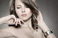 Young woman wearing a ring and a bracelet, beauty shot, portrait