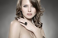 Young woman wearing a ring, beauty shot, portrait