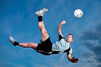 soccer player in a bicycle kick