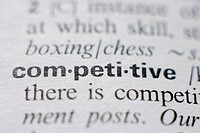 Dictionary page with competitive definition, close up