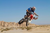 USA, California, Motocrosser jumping on Palm Desert