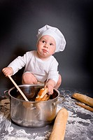 Little boy cook with kitchen accessories and hat