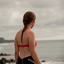 Woman on the coast looking at a view, Playa Ochoa, San Cristobal Island, Galapagos Islands, Ecuador