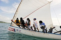 skiff race during the Yoles Festival, Sainte-Anne Bay, Martinique, french island overseas region and department in the Lesser Antilles in the eastern ...