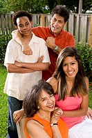 African American and Hispanic interracial family together in backyard