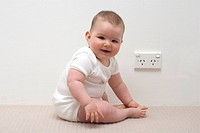 Baby near Australian power point or socket