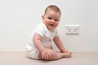 Baby near Australian power point or socket