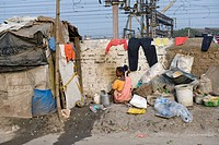 Slum alongside the railway line, Shibpur district, Howrah, Kolkata, West Bengal, India, Asia