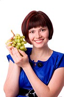 Woman holding a bunch of green grapes isolated against white background. Girl with fruit, happy face, healthy lifestyle. Healthy female eating grapes.