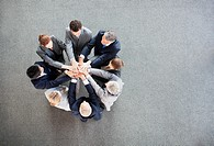Business people stacking hands in circle (thumbnail)