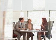 Business people talking at table in conference room