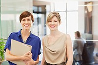 Portrait of smiling businesswomen in office