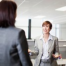 Businesswoman gesturing and talking to co_workers