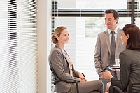 Business people talking in office (thumbnail)