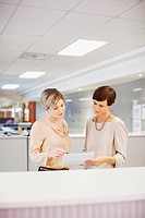Businesswomen reviewing paperwork in office