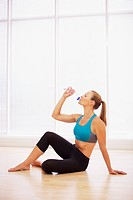 Woman in sports bra drinking water