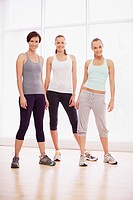 Portrait of smiling women in fitness studio