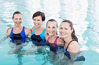 Portrait of smiling women in swimming pool