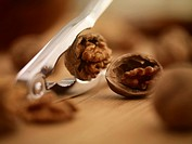 Close up of walnuts being cracked