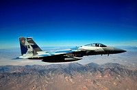 An F-15E Strike Eagle from the 65th Aggressor Squadron flies in support of and dogfights against members of the Air Force Weapons School over Nellis A...