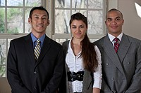 Portrait of a Hispanic businessman standing with his colleagues
