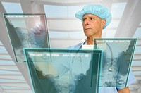 Doctor in uniform with high_tech screen in the hospital