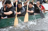 Team dragon boat racing. A method of team building used by many corporations to build team spirit and increase the effectivesness of working together ...