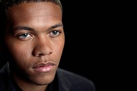 Portrait of young African American male in business suit