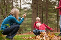 Woman signing the word Go in American Sign Language while communicating with her son in a park