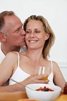 Man kisses his wife
