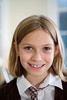 Portrait of cheerful girl wearing uniform