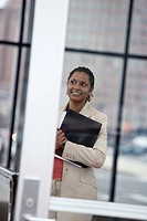 A business woman smiling with file in her hand